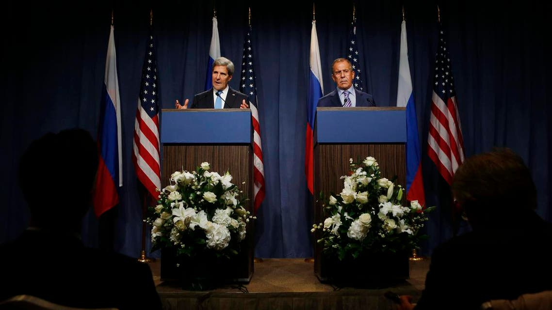 U.S. Secretary of State John Kerry gestures next to Russian Foreign Minister Sergey Lavrov (R) as they speak to the media before their meeting to discuss the ongoing crisis in Syria reuters