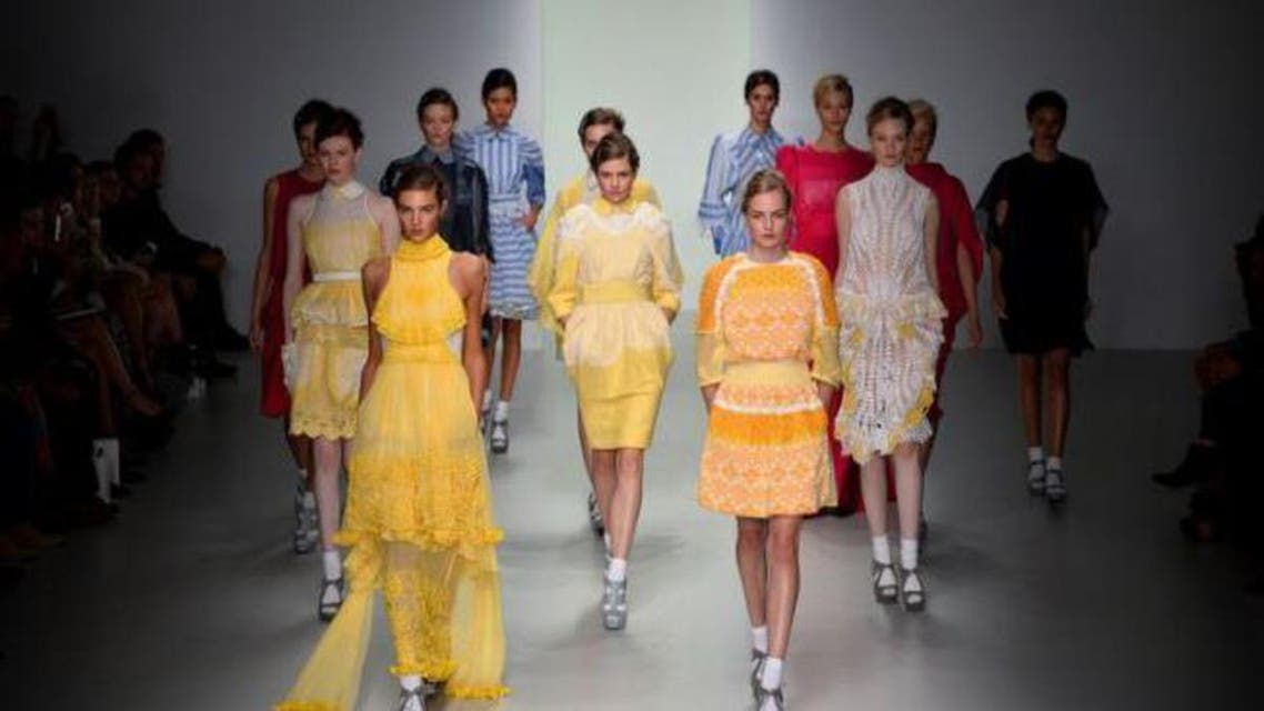 Models present creations by Bora Aksu during the 2014 Spring/Summer London Fashion Week in London on September 13, 2013. (AFP,