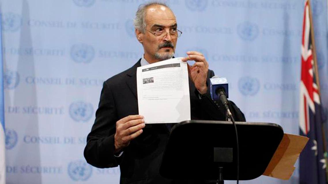 Syrian U.N. Ambassador Bashar Ja'afari shows a document to reporters at the United Nations Headquarters in New York, September 12, 2013.  (Reuters)