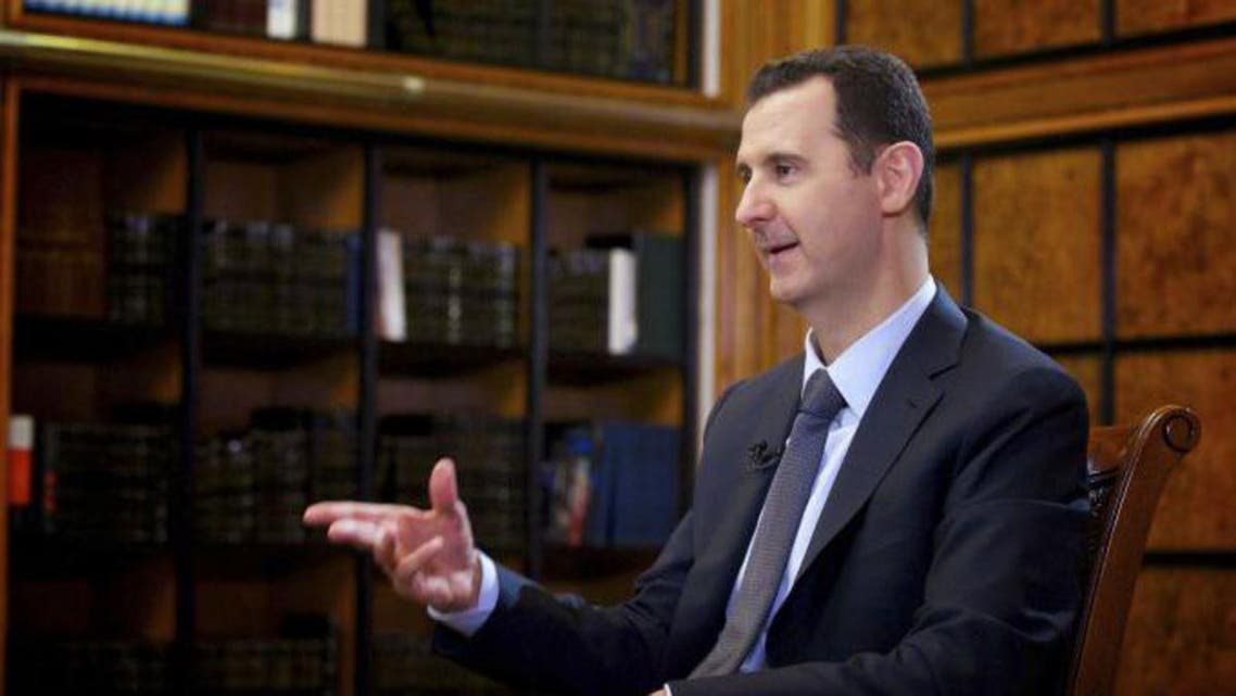 Syria's President Bashar al-Assad speaks during an interview with Russian state television RU24 in Damascus in this September 12, 2013 handout photo by Syria's national news agency SANA. reu