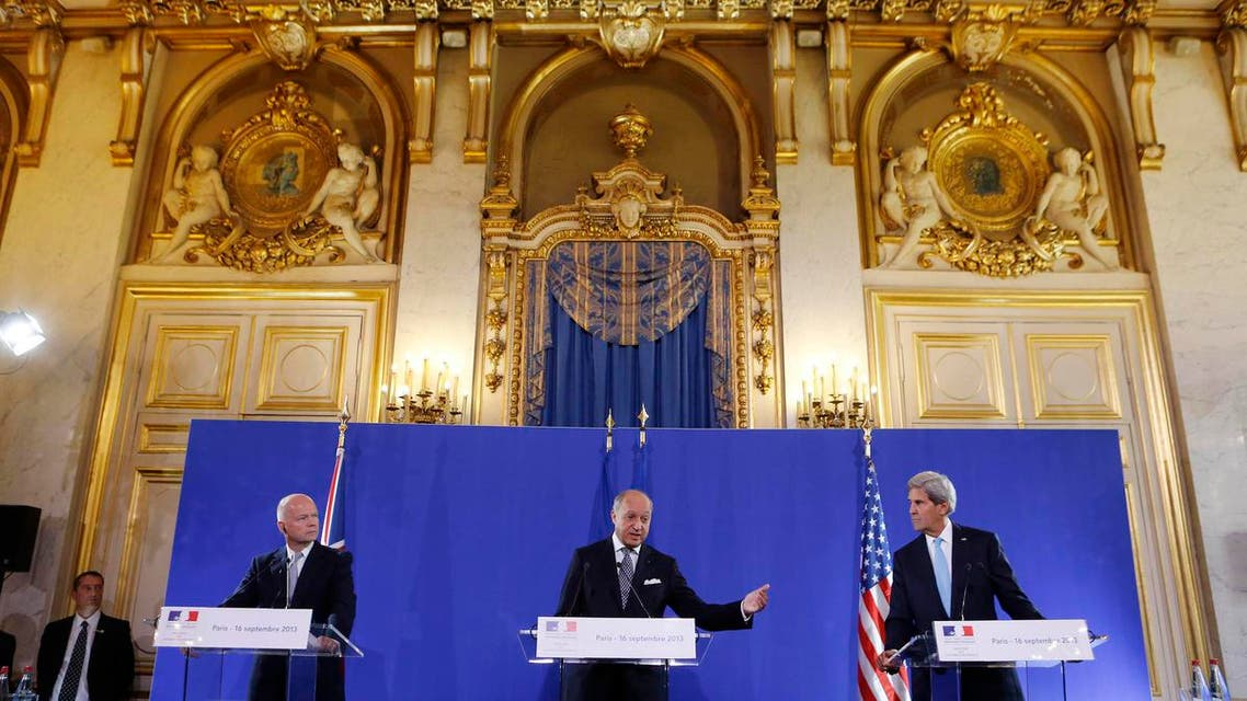U.S. Secretary of State John Kerry (R) and British Foreign Secretary William Hague (L) listen to French Foreign Minister Laurent Fabius speak at a news conference after a meeting regarding Syria, at the Quai d'Orsay in Paris September 16, 2013. reu