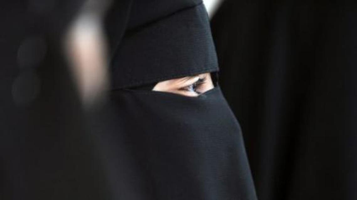 File picture shows a Muslim woman wearing the niqab in Montreuil near Paris on May 18, 2010 (AFP