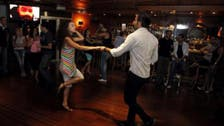 Damascus clubbers dance on in bid to forget war outside