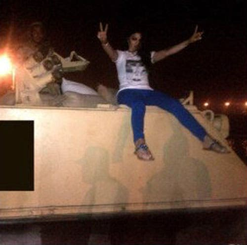 Haifa Wehbe posing on top of an Egyptian army tank next to a soldier. (File photo: Twitter)