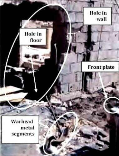 A picture released in a United Nations report September 16, 2013 on possible use of chemical weapons in Syria shows damage to a wall and floor, which inspectors believe was caused by a rocket attack. (Reuters)