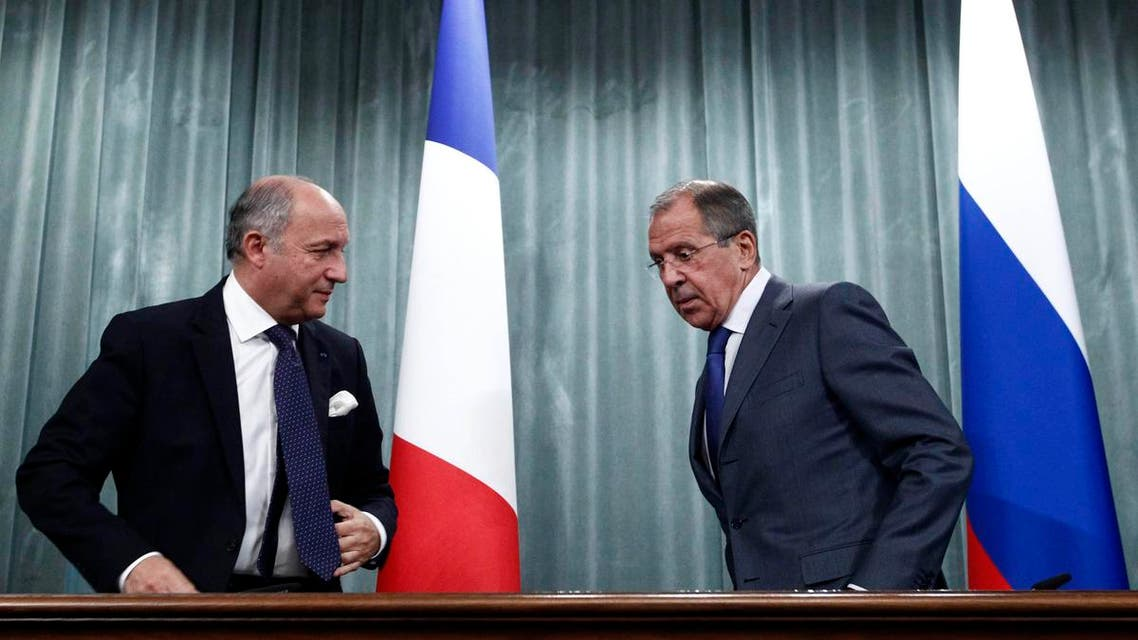 Russia's Foreign Minister Sergei Lavrov (R) and his French counterpart Laurent Fabius attend a news conference in Moscow, Sept. 17, 2013.  (Reuters)