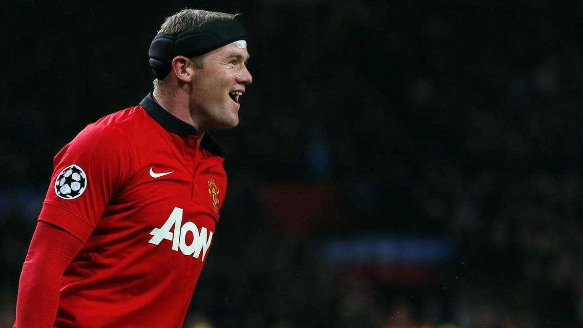 anchester United's English striker Wayne Rooney celebrates scoring a goal during the UEFA Champions League Group A football match football match between Manchester United and Bayer Leverkusen at Old Trafford in Manchester, north west England on September 17, 2013.