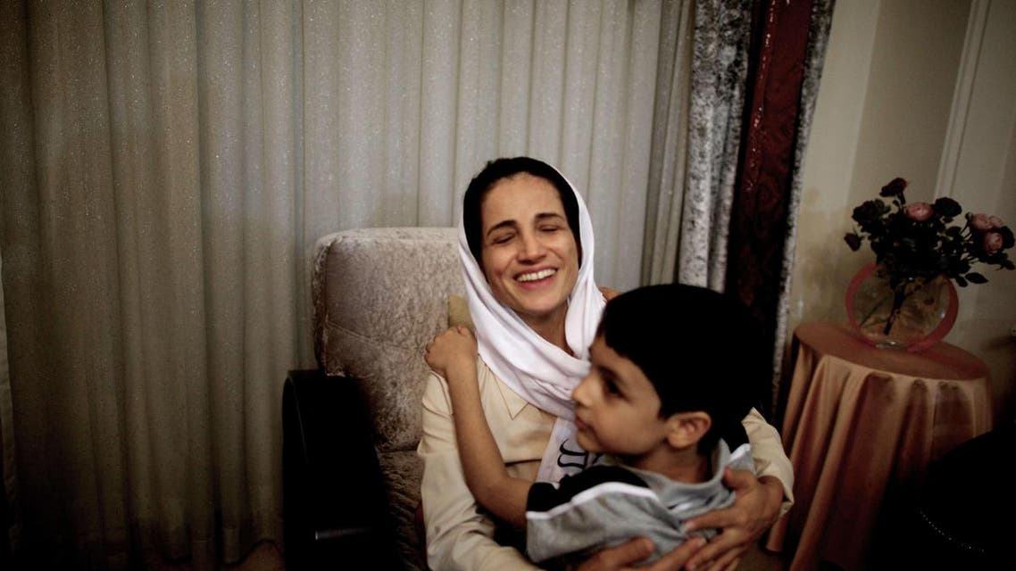 Iranian lawyer Nasrin Sotoudeh hugs get son Nima at her home in Tehran on Sept. 18, 2013, after being freed after three years in prison. (AFP)