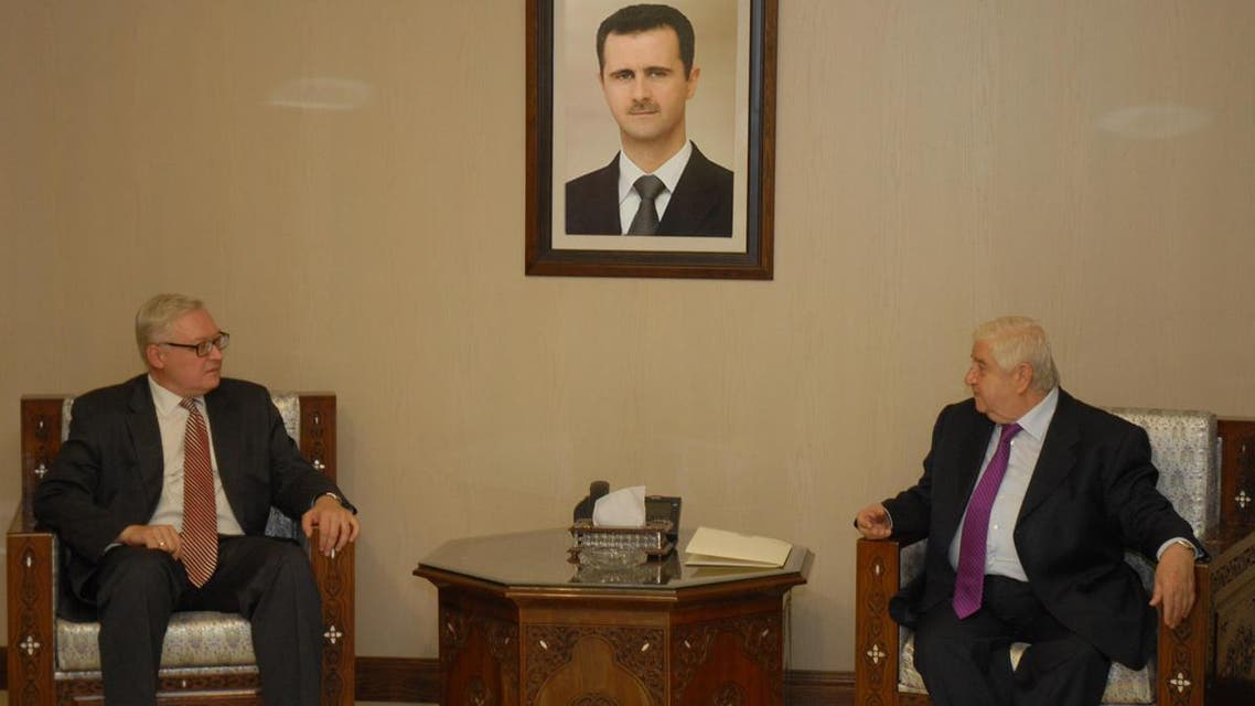 Syrian Foreign Minister Walid al-Muallem (R) meets Russian deputy Foreign Minister, Sergei Ryabkov,in Damascus,in this handout photograph distributed by Syria's national news agency SANA on September 17, 2013. (Reuters)