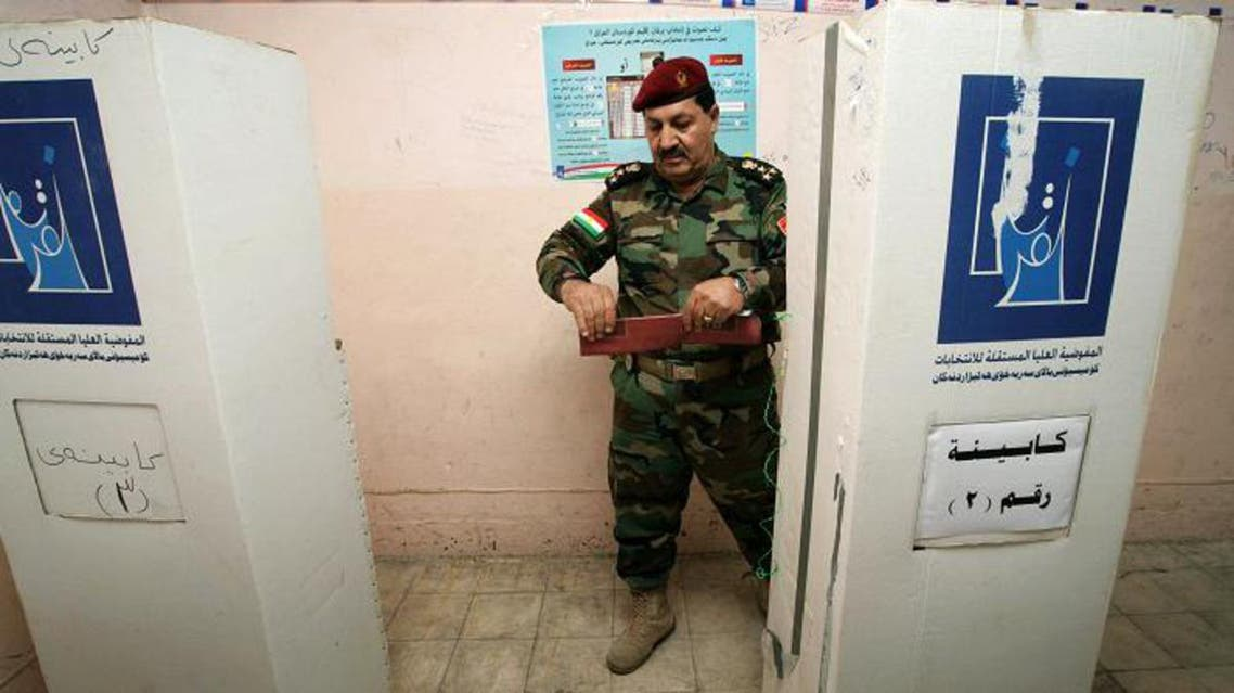 A member of a Kurdish Peshmerga battalion leaves the voting booth before casting his ballot during the region's legislative elections at a polling station on September 19, 2013 in the northern Kurdish city of Arbil.