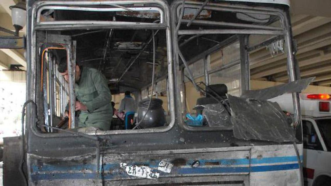 A file photo shows a damaged bus at the site of a bomb attack in the Midan neighborhood in the heart of  Damascus earlier in 2012.  (AFP)