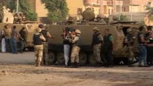 Egyptian forces seize control of Cairo district after clash with militants