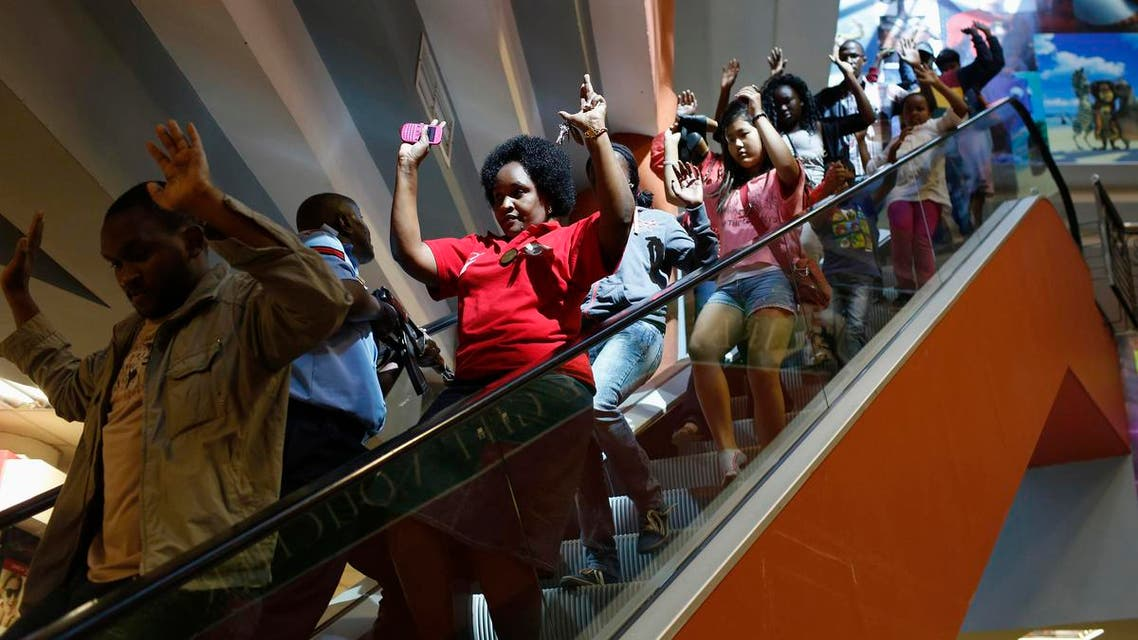 Civilians escape an area at the Westgate Shopping Centre in Nairobi, Kenya, on September 21, 2013. (Reuters)