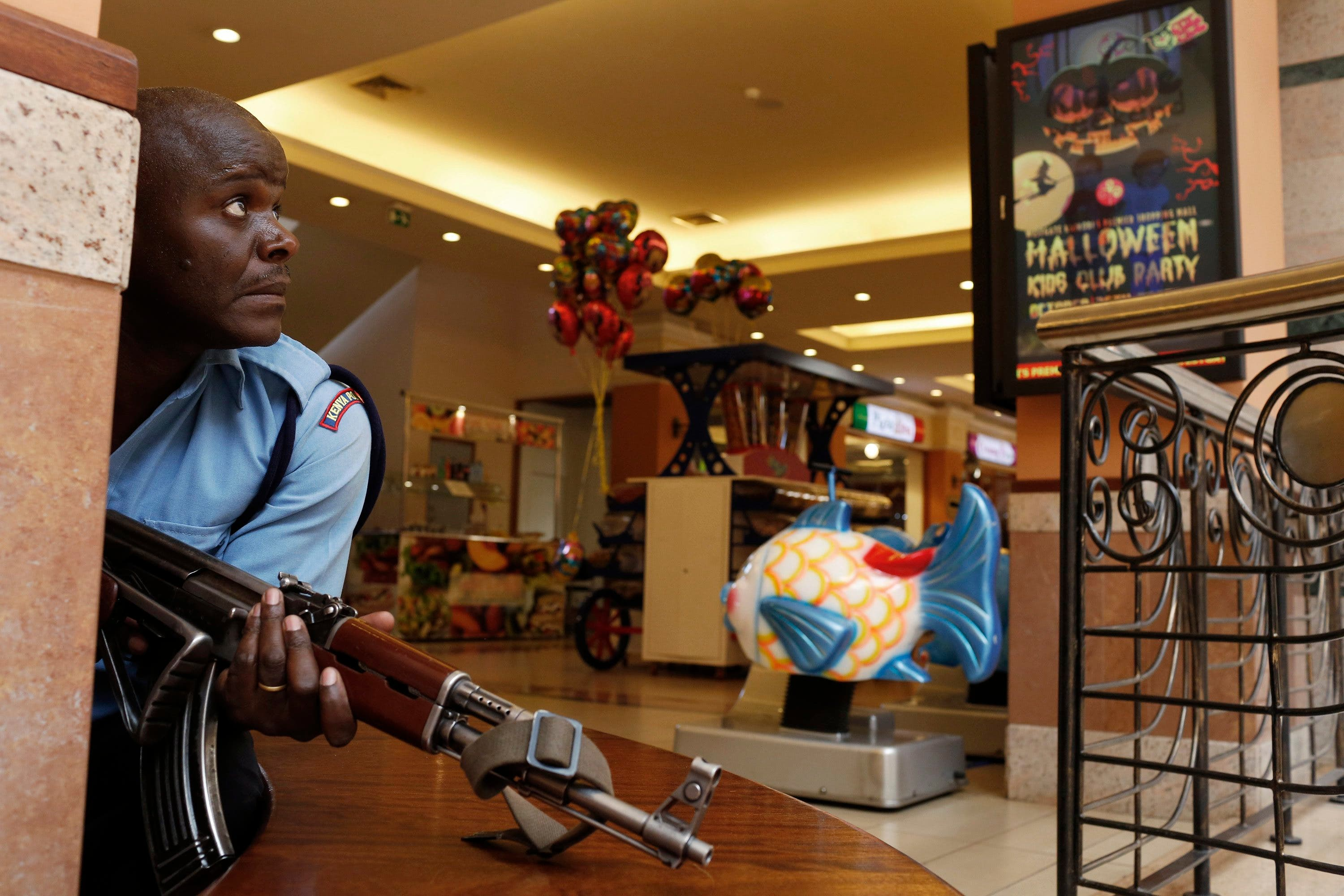 A police officer tries to secure an area inside the Westgate Shopping Centre where gunmen went on a shooting spree in Nairobi. (Reuters)