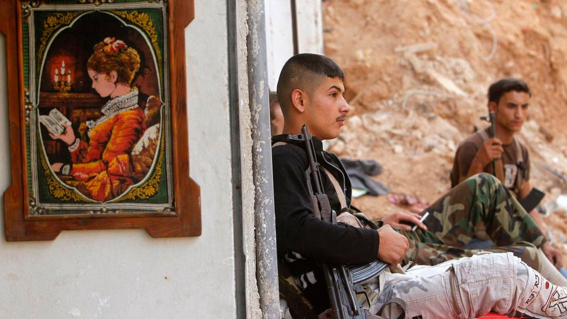 A Free Syrian Army fighter rests in Ashrafieh, Aleppo September 21, 2013. (Reuters)