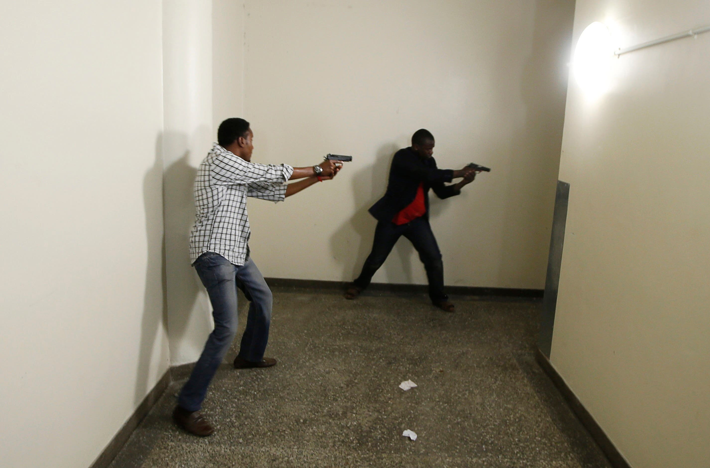 Armed police search Westgate Shopping Centre in Nairobi. (Reuters)