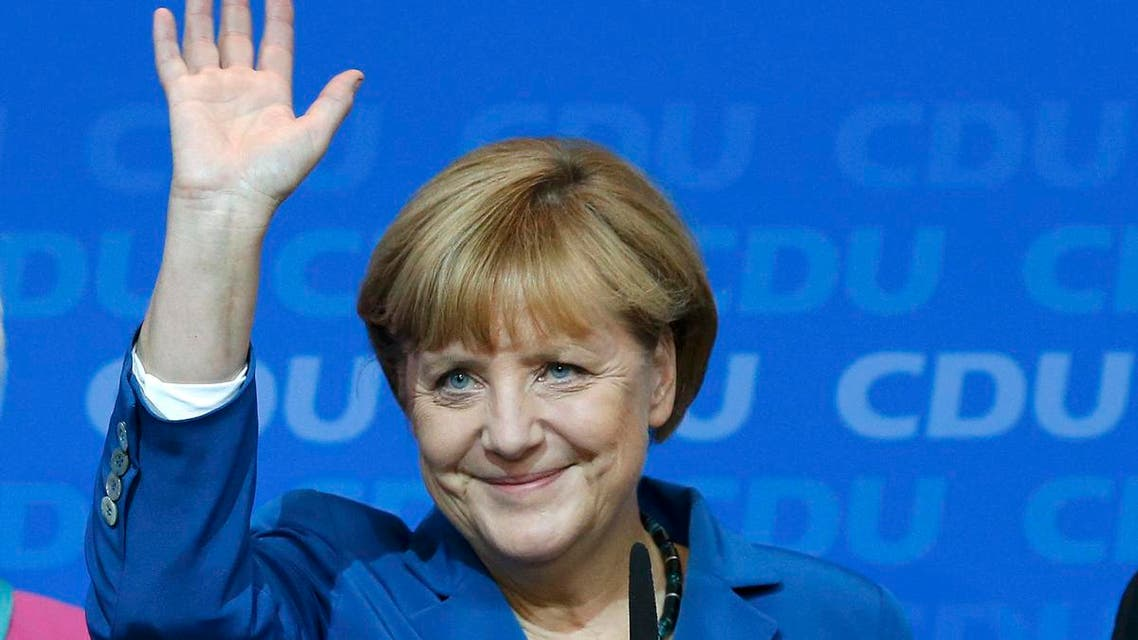 German Chancellor and leader of Christian Democratic Union (CDU) Angela Merkel waves to supporters after first exit polls in the German general election (Bundestagswahl) at the CDU party headquarters in Berlin September 22, 2013.