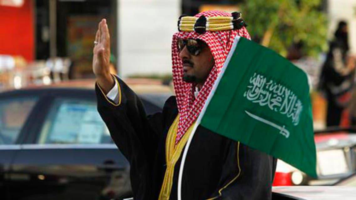 A man celebrates Saudi National Day in Riyadh on September 23, 2012.