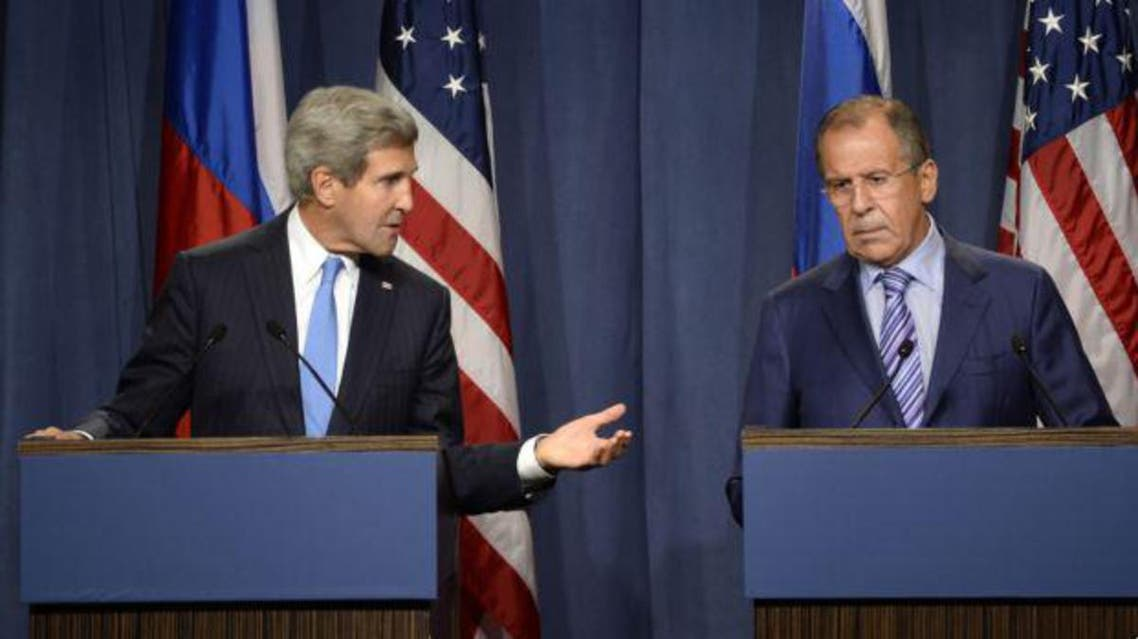 Russia's Foreign Minister Sergey Lavrov (R) and U.S. Secretary of State John Kerry hold a news conference at a hotel in Geneva September 12, 2013.  afp
