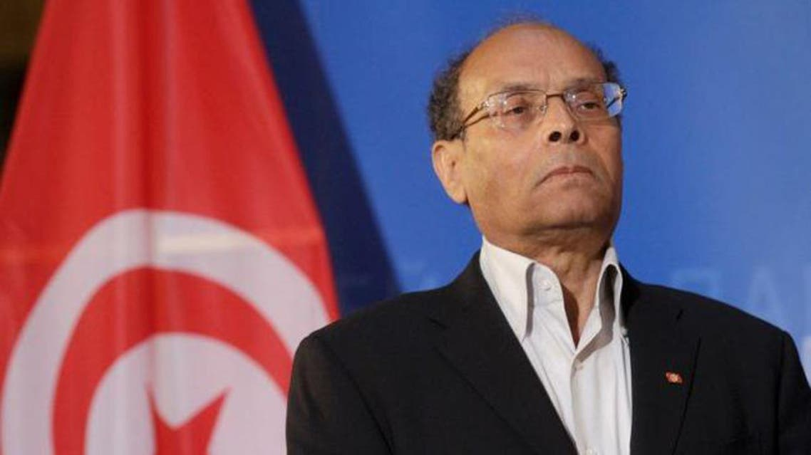 Tunisia's President Moncef Marzouki listens his national anthem at the European Parliament in Strasbourg, February 6, 2013. reu