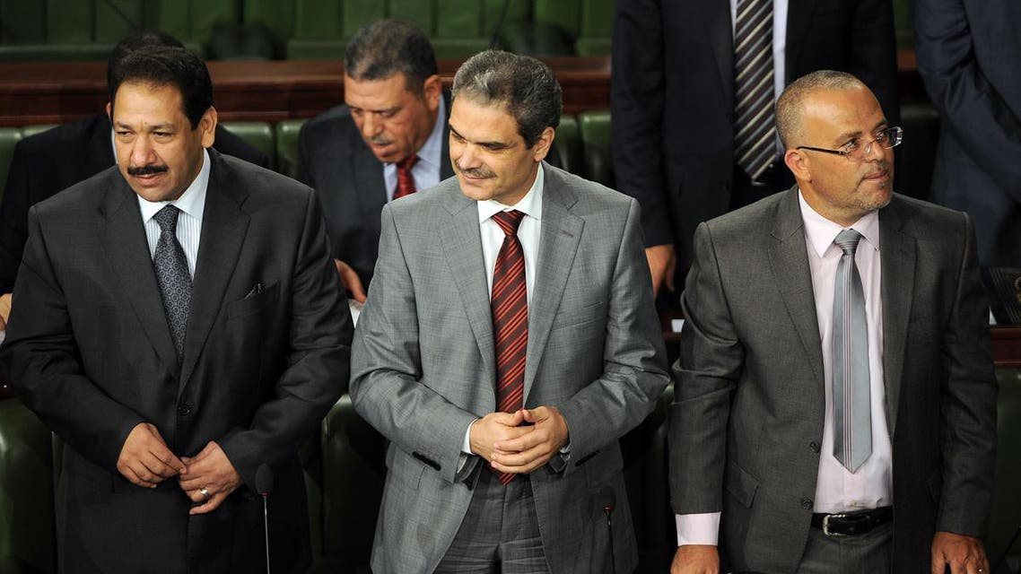 unisian Interior Minister Lotfi Ben Jeddou (L), Justice Minister Nadhir Ben Ammou (C) and Minister of Human Rights and Transitional Justice Samir Dilou (R) attend a constituent assembly meeting on Sept. 19, 2013 to discuss security issues. (AFP)
