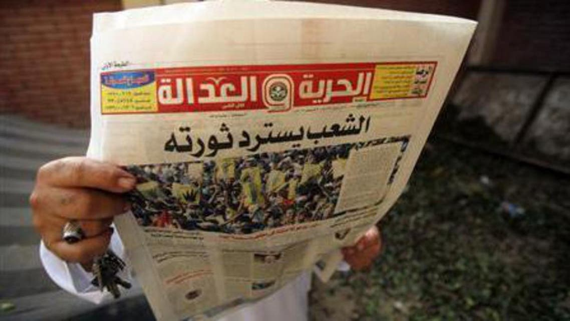 A man reads the Brotherhood's newspaper Al-Hurriya wa-l-adala (Freedom of Justice), named after their political party, in Cairo, September 3, 2013. (Reuters)