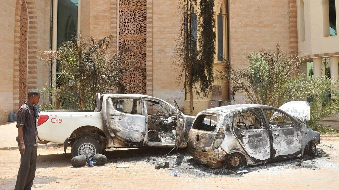 A man looks at burnt vehicles on Sept. 26, 2013 in the Sudanese capital Khartoum after rioting erupted following a decision of the government to scrap fuel subsidies. (AFP)