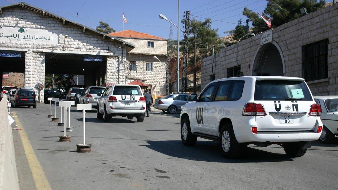 A convoy of United Nations vehicles is seen at the Lebanon-Syria Masnaa border crossing on October 1, 2013 afp