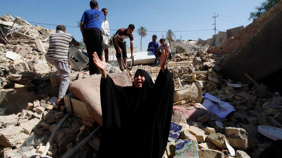A woman reacts at the site of a suicide bomb attack on Shi'ite mosque in Mussayab, 60km (40 miles) south of the capital Baghdad, September 30, 2013.