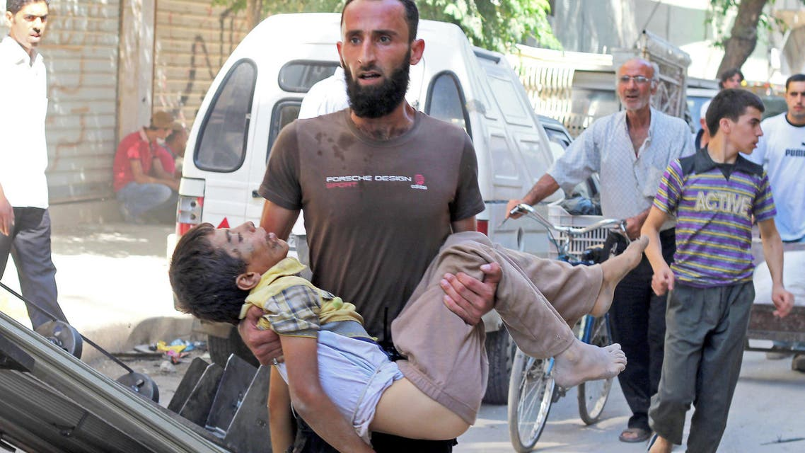 A man carries the body of a child allegedly killed by a pro-government forces sniper in the northern Syrian city of Aleppo on Oct. 2, 2013. (Reuters)