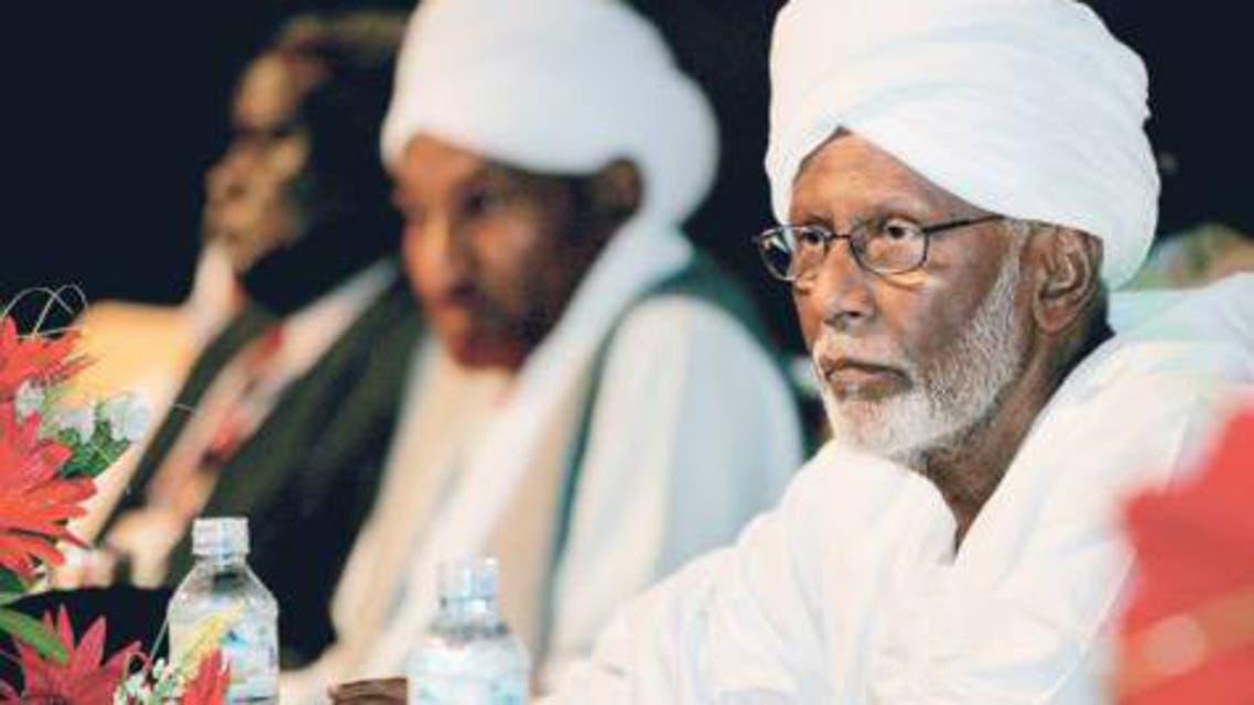 Sudanese opposition leader Hassan Turabi (right)