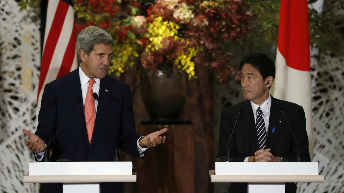 Secretary of State John Kerry (L) and Japan's Foreign Minister Fumio Kishida attend their joint news conference in Tokyo on October 3, 2013. (AFP)