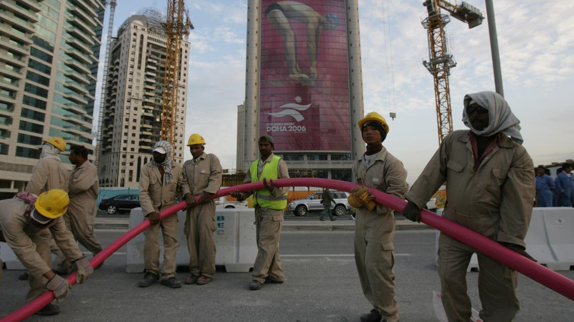 Asian workers in Doha, three days before the opening ceremony of the 15th Asian Games. (File photo: AFP)