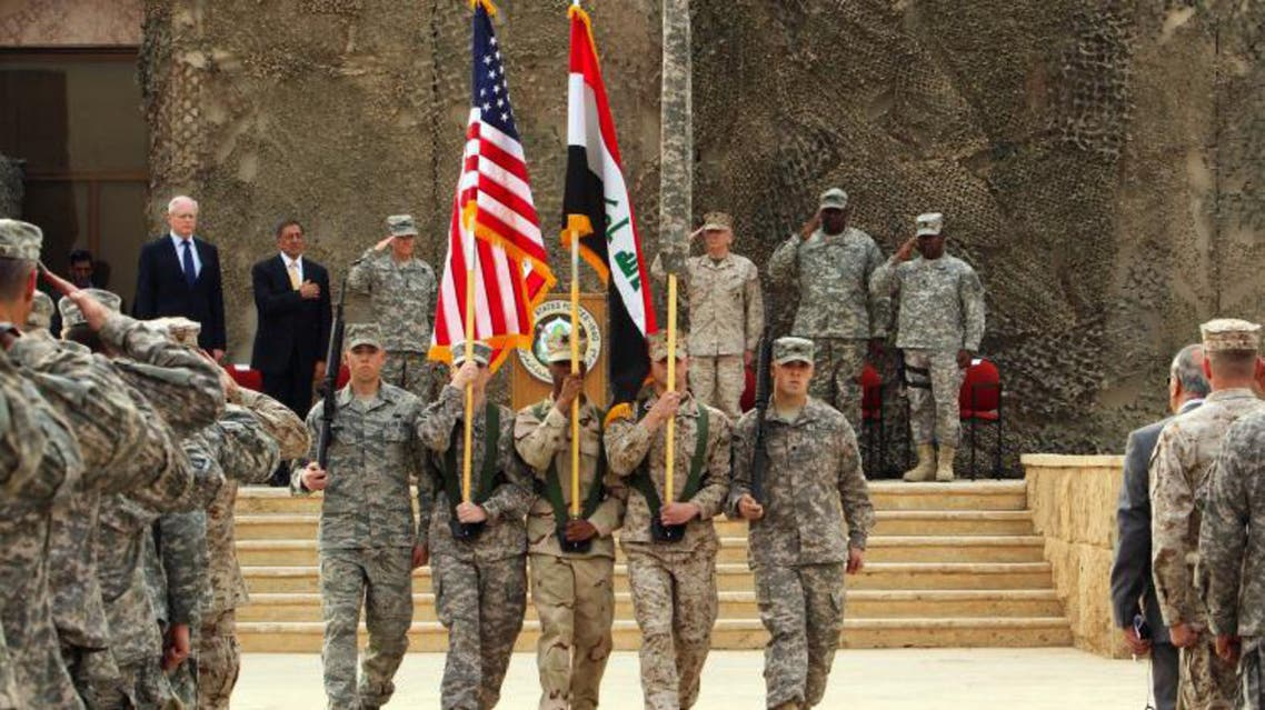 A flag-lowering ceremony is held to mark the end of U.S. forces mission in Iraq at an American base west of Baghdad,. (File Photo: AFP)