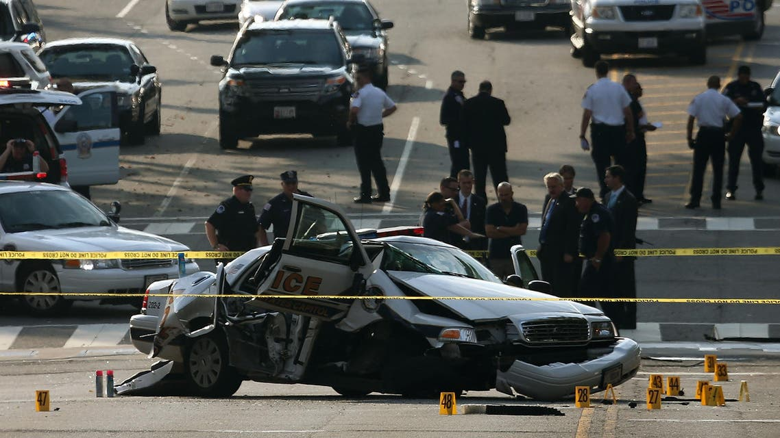 Law enforcement personnel gather around a police vehicle that was involved in an incident with another vehicle on Constitution Avenue outside the U.S. Capitol October 3, 2013 in Washington, DC. (AFP)