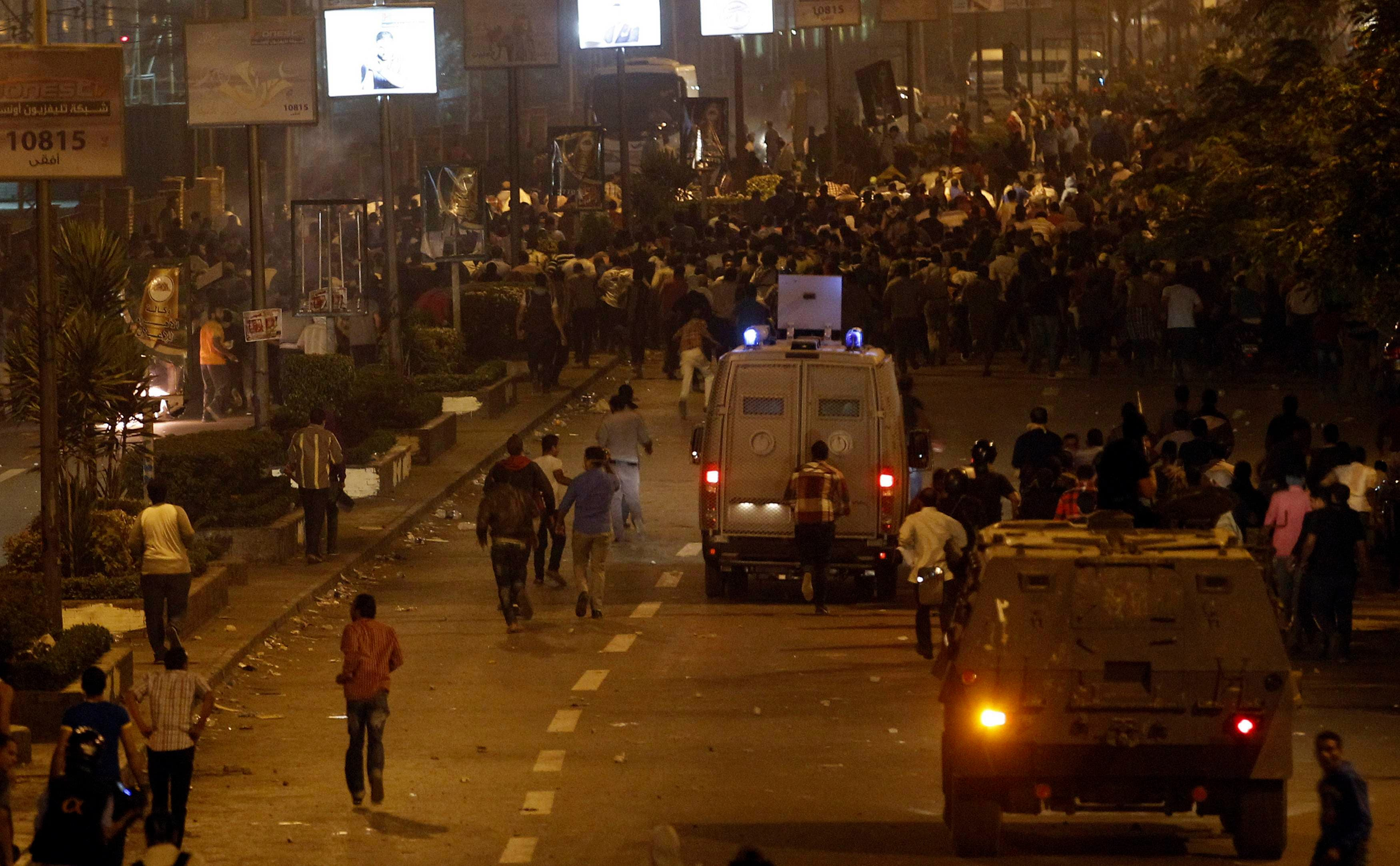 Riot police armored personnel carriers fire rubber bullets and tear gas at members of the Muslim Brotherhood and supporters of ousted Egyptian President Mohamed Mursi during clashes along a road at Ramsis square. (Reuters)