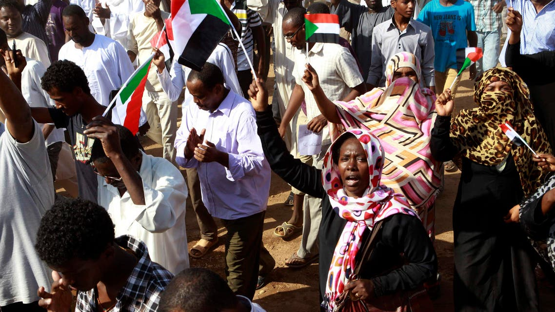 People chant slogans against the government's deadly crackdown on protesters against subsidy cuts late last month, during a demonstration after Friday prayers in north Khartoum October 4, 2013.  (Reuters)