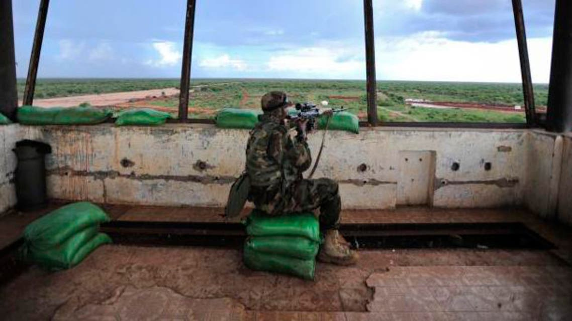 A sniper in a control tower checks surrounding areas for al-Shabaab militants (Handout/Courtesy Reuters).