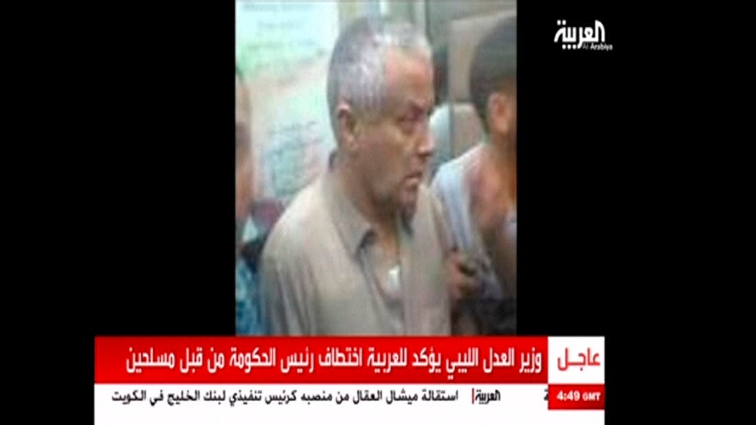 LIBYA/ An undated still image aired by broadcaster Al Arabiya shows what it says is Libyan Prime Minister Ali Zeidan surrounded by men at an unidentified location. (Al Arabiya)