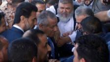 Libya's PM Ali Zeidan appears in cabinet after release