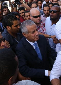 Libyan Prime Minister Ali Zeidan arrives at the government headquarters in Tripoli on October 10, 2013 shortly after he was freed. (AFP)
