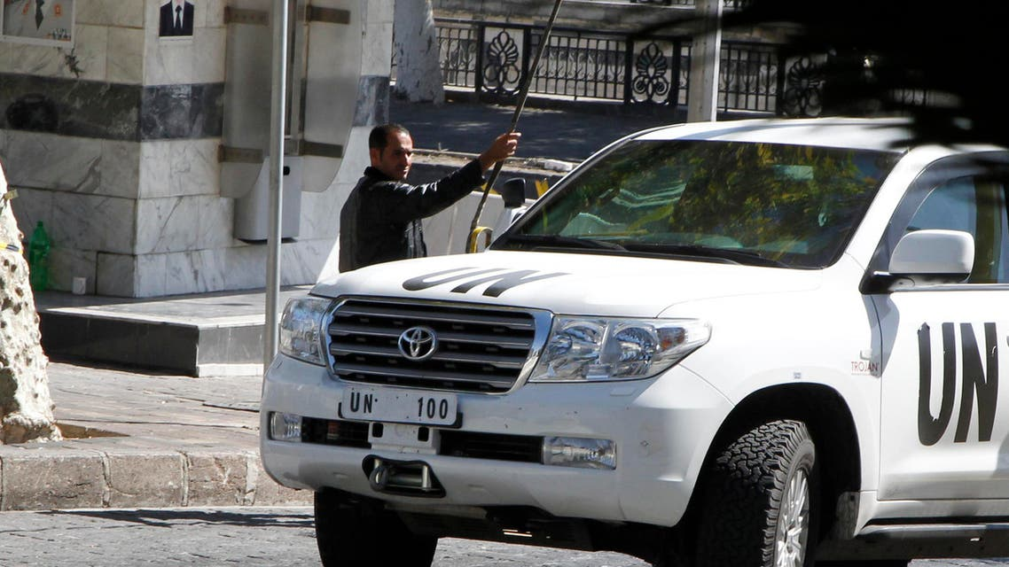 A U.N. vehicle returns to a hotel where experts from the Organisation for the Prohibition of Chemical Weapons (OPCW) are staying, in Damascus October 11, 2013.  (Reuters)