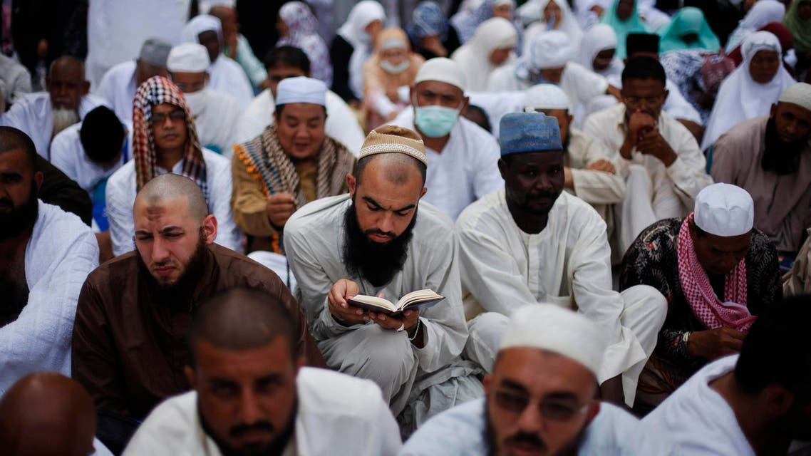 A Muslim pilgrim reads the Koran as he attends Friday prayers at the Grand mosque in the holy city of Mecca ahead of the annual haj pilgrimage October 11, 2013.