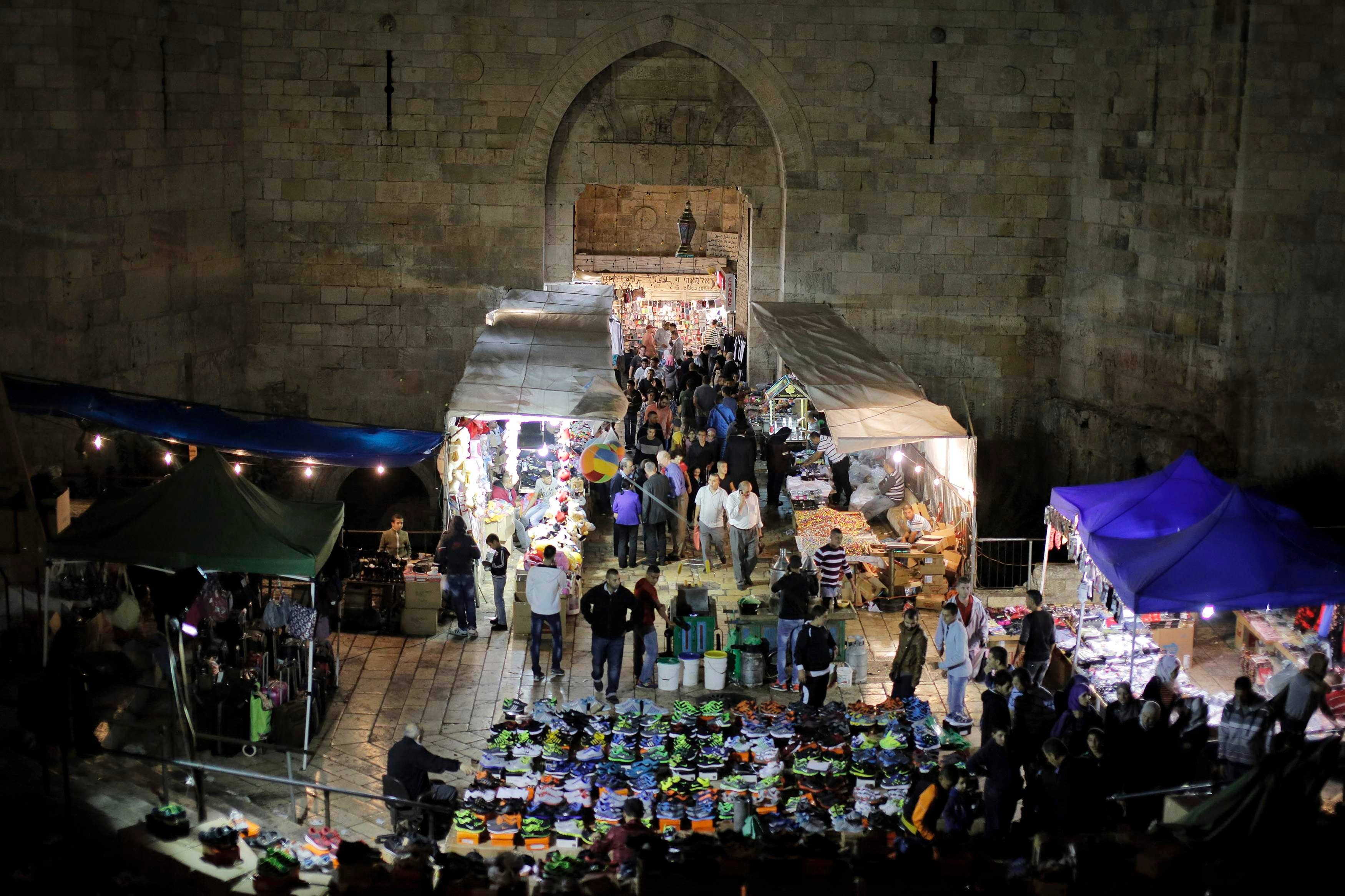 PALESTINE: Palestinians shop at a market ahead of Eid al-Adha at Damascus Gate in Jerusalem's Old City October 14, 2013. (Reuters)