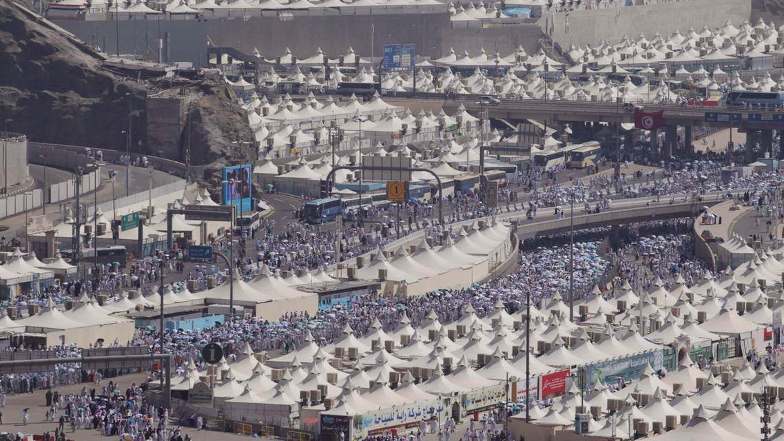 Muslim pilgrims arrive to cast seven pebbles at a pillar that symbolizes Satan during the annual haj pilgrimage, on the first day of Eid al-Adha in Mina, near Islam's holy city of Makkah, October 15, 2013. (Reuters)
