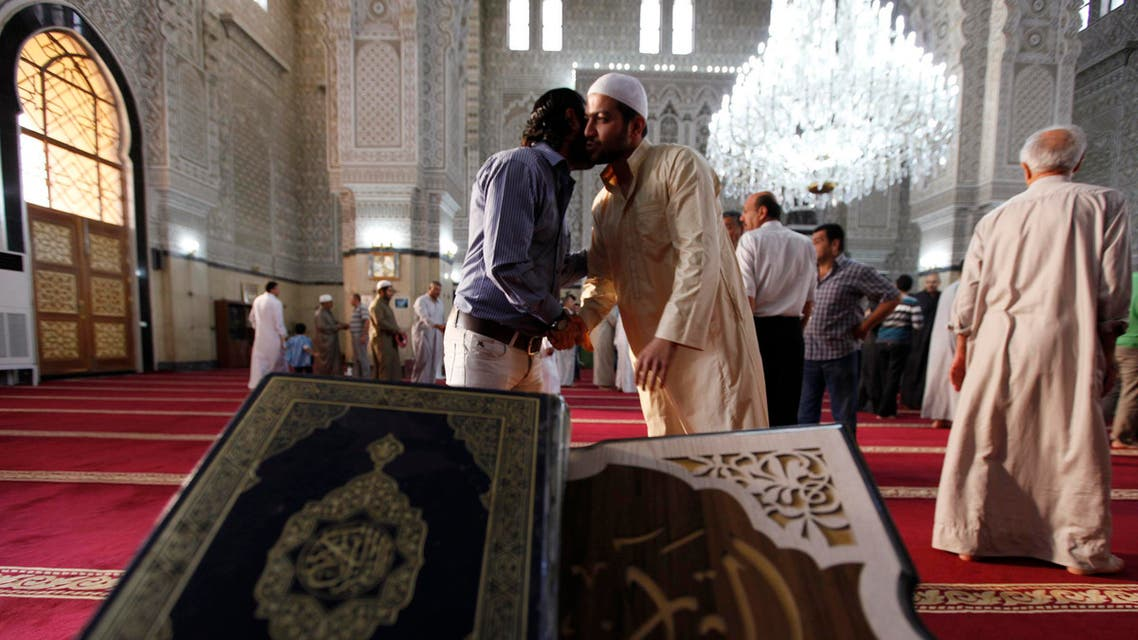 IRAQ: Sunni worshippers greet each other after attending prayers at a Sunni mosque on the first day of the Muslim festival of Eid-al-Adha in Baghdad, October 15, 2013. (Reuters)