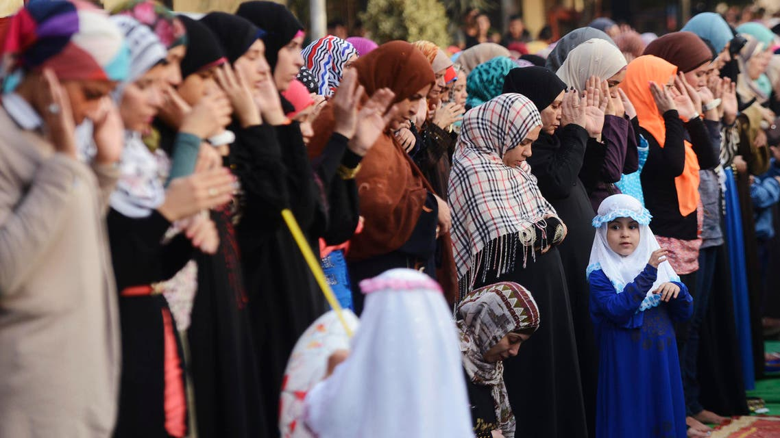 Muslims pray during Eid al-Adha at Amr Ibn El-Aas mosque in Cairo October 15, 2013. (Reuters)