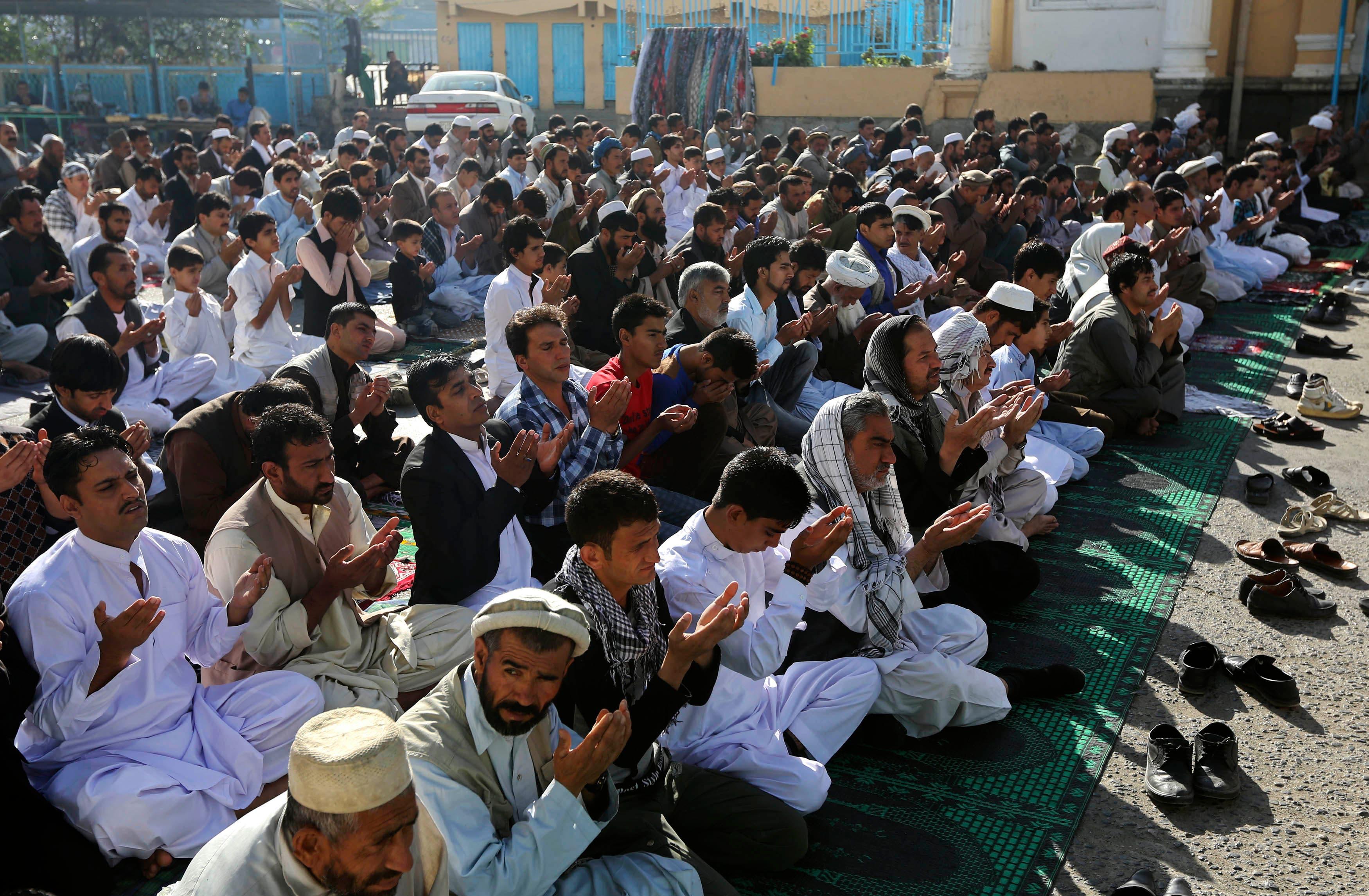 AFGHANISTAN: Afghan men pray during Eid al-Adha prayers in Kabul October 15, 2013.  (Reuters)