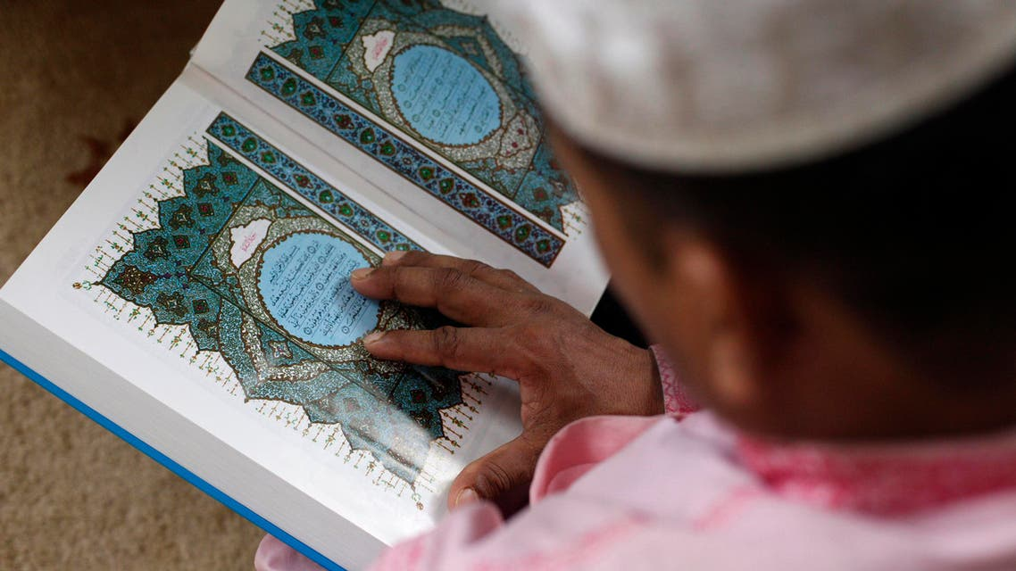 SINGAPORE: A Muslim reads in a mosque after Eid al-Adha prayers on October 15, 2013. (Reuters)