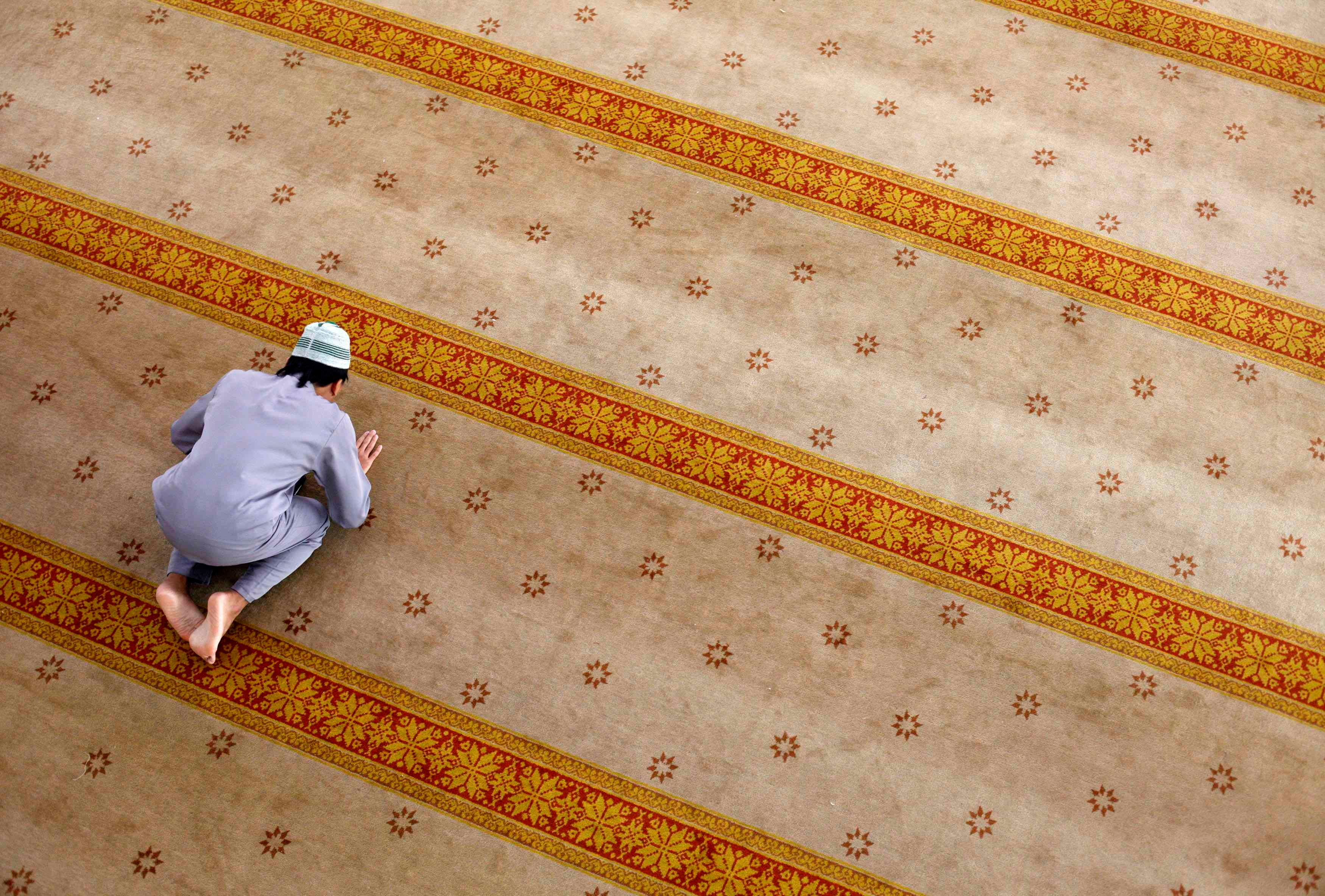 SINGAPORE: A Muslim prays at a mosque during Eid al Adha in Singapore October 15, 2013. (Reuters)